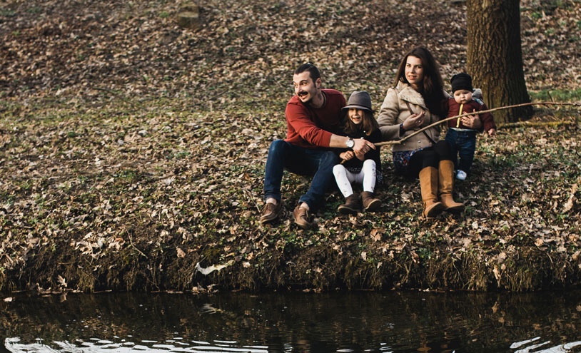 family on river bank