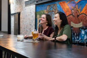 girls enjoying beer at waco ale company