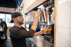man pouring beer
