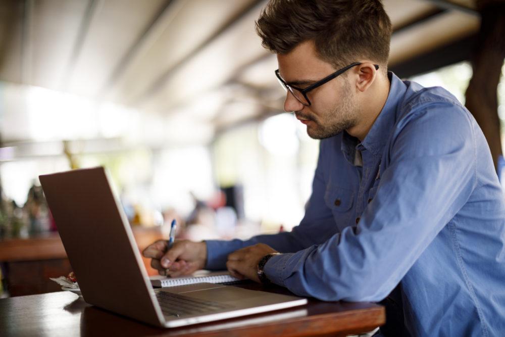 man working at computer
