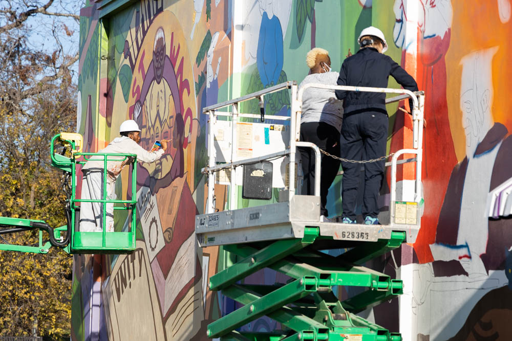 artists working on the mural