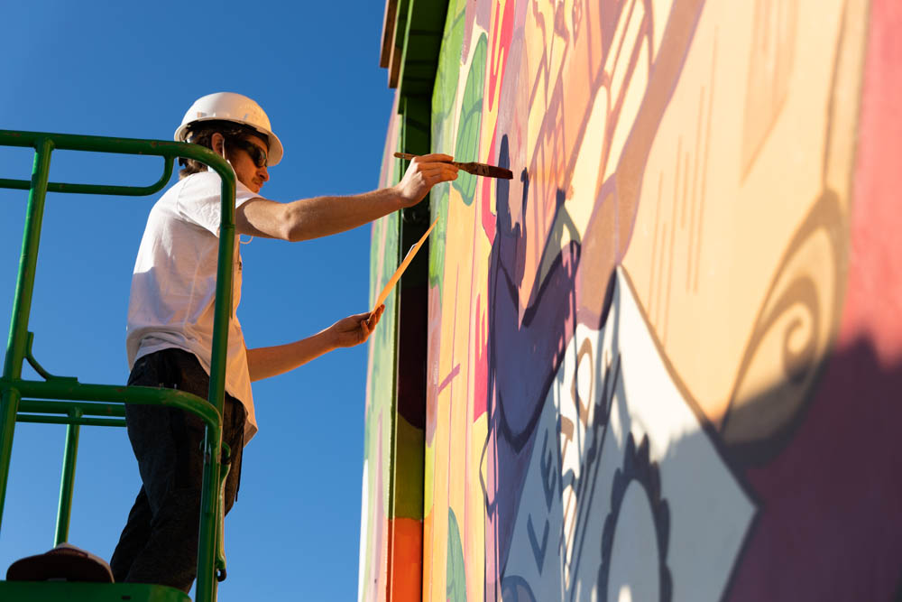cade doing some detail work on the mural