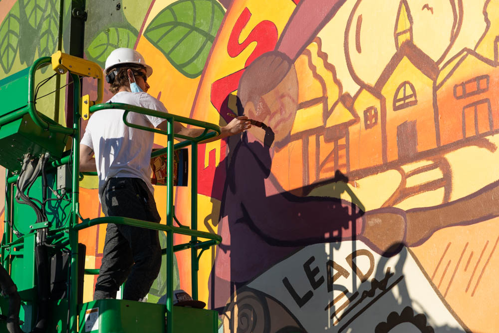 cade working on the mural