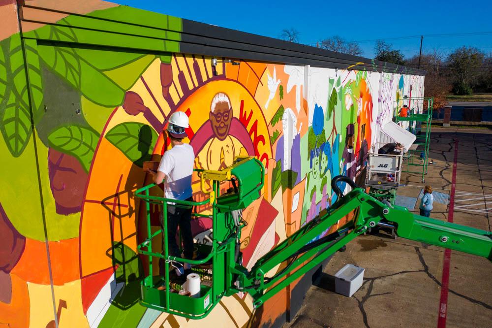 cade kegerreis working on the mural